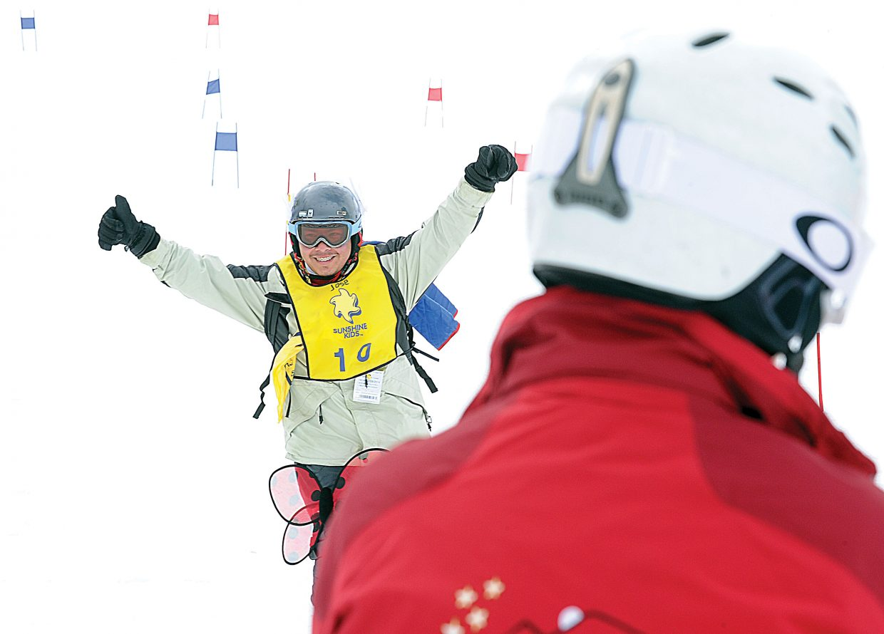 Jose Tepozotlan, of Houston, celebrates as he crosses the finish line during the Sunshine Kids Winter Olympic Games in Steamboat Springs on Friday morning. The Sunshine Kids is a nonprofit organization dedicated to children with cancer. It provides positive group activities and emotional support for young cancer patients, and brings a group to Steamboat Ski Area each year.