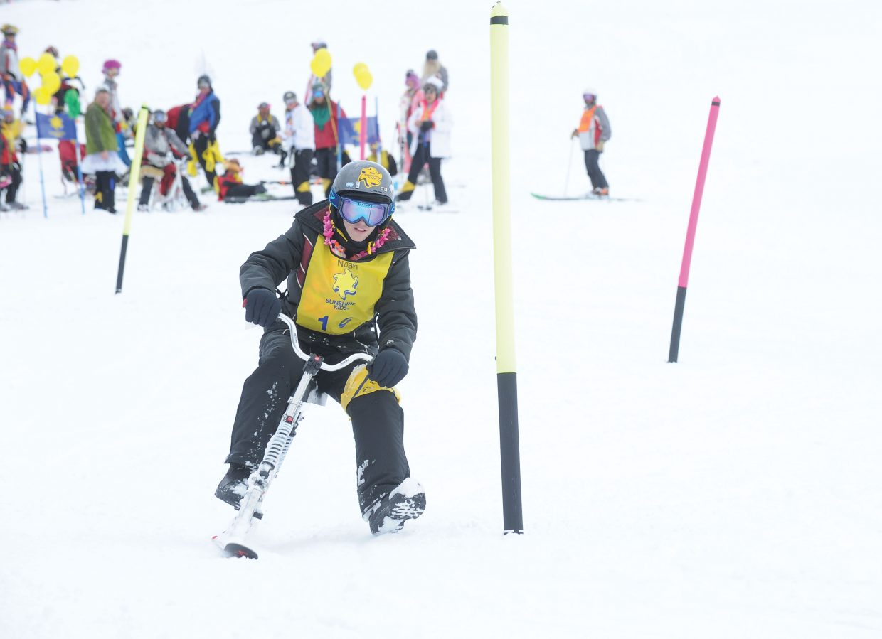 Noah Elliott, of St. Charles, Mo., cruises through a slalom course on the Bashor ski run Friday at Steamboat Ski Area during the Sunshine Kids Winter Games. The Sunshine Kids is a nonprofit organization dedicated to children with cancer. It provides positive group activities and emotional support for young cancer patients, and brings a group to Steamboat Ski Area each year.
