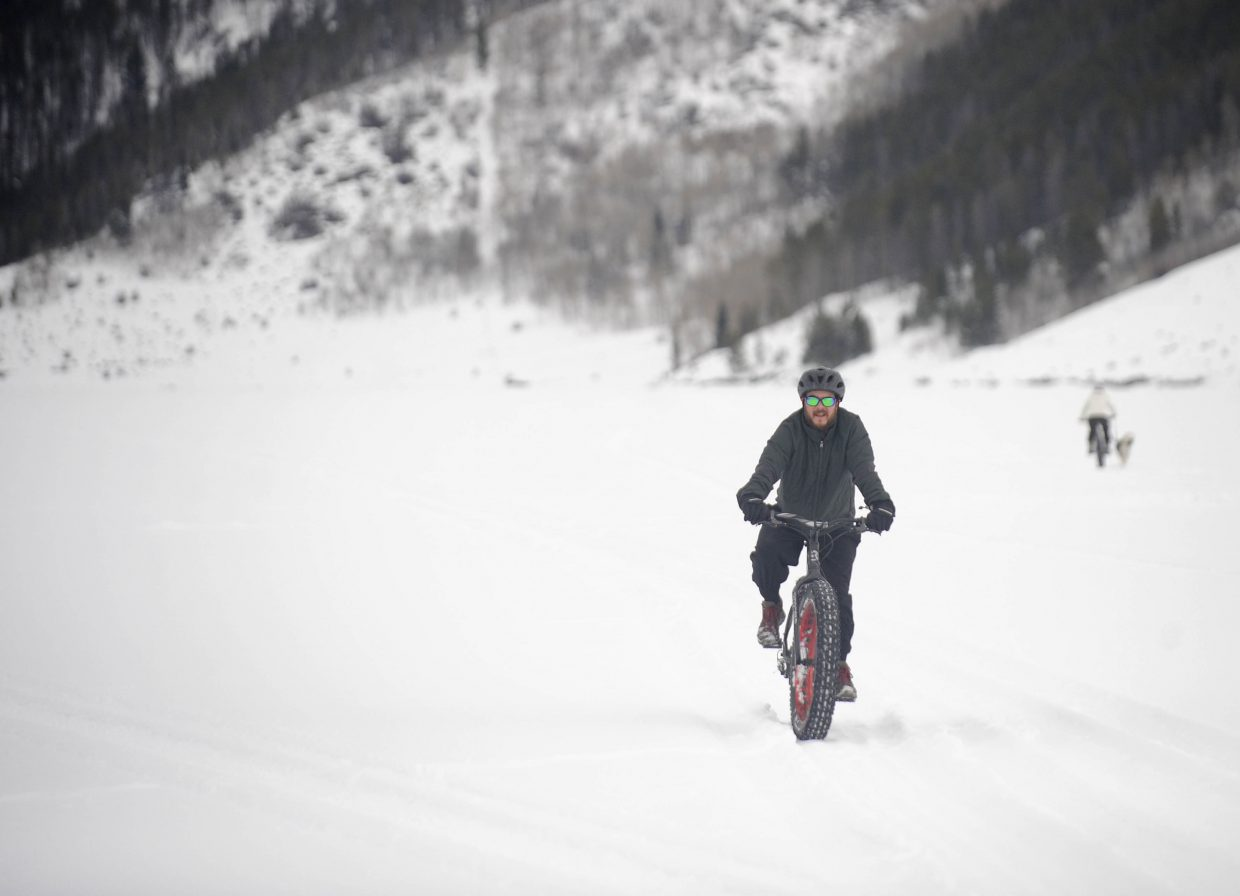 Brett Dalke tries out a fat bike on the frozen Stagecoach Reservoir during the Debunk the Winter Funk event Saturday at Stagecoach State park.