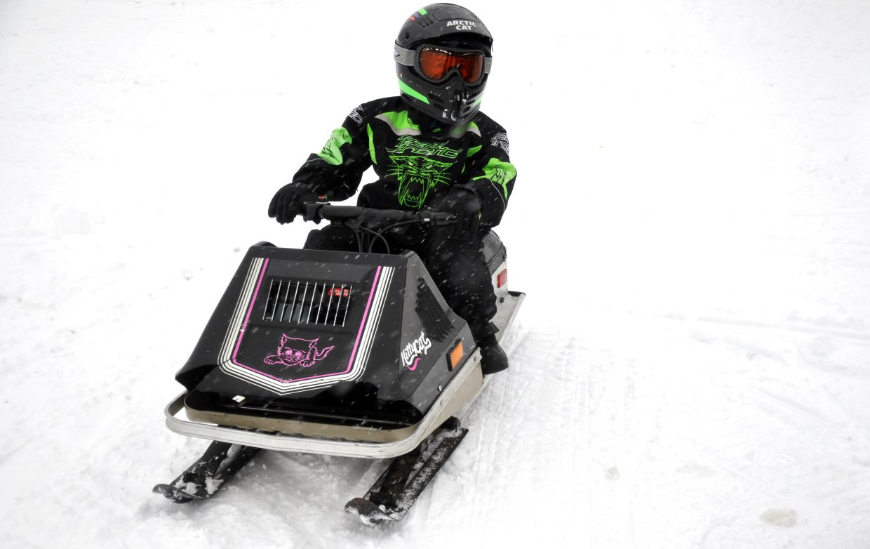 Carter Chase rides a 1980 Arctic Cat Kitty Cat on Saturday.