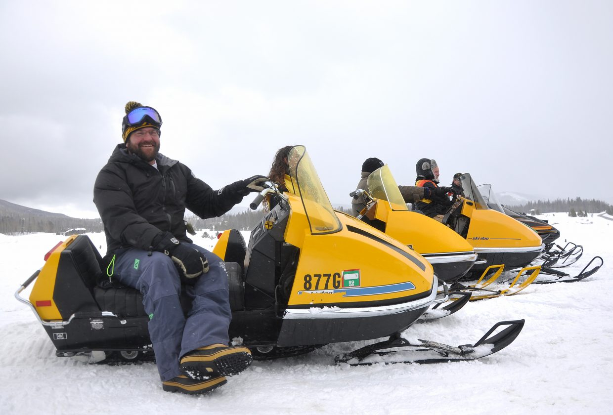 Darren Zamzow and other snowmobile riders pose with their vintage snowmobiles on Saturday.