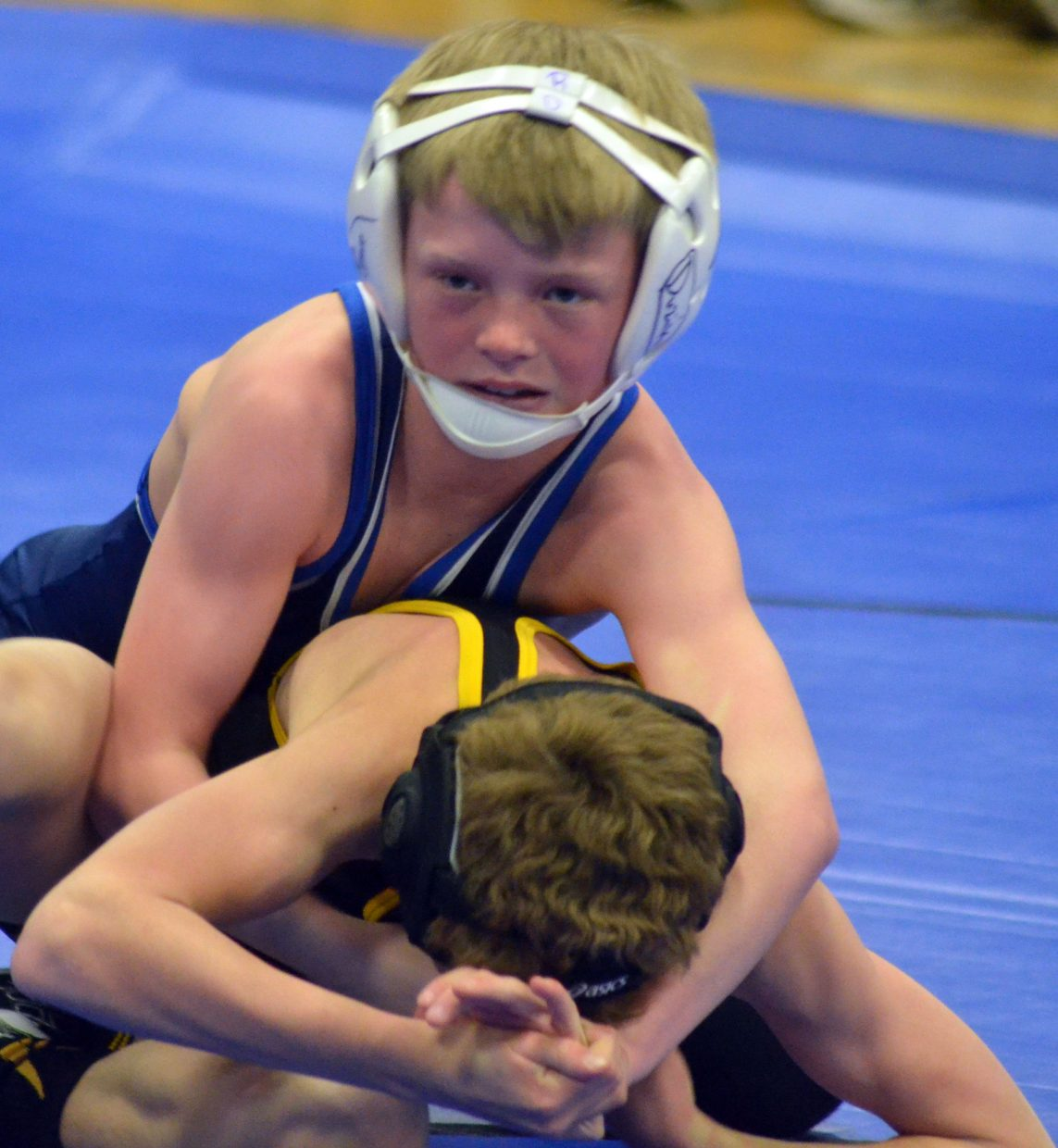 Craig Middle School's Ryan Duzik stays on top of things against Meeker opponent Cole Rogers.