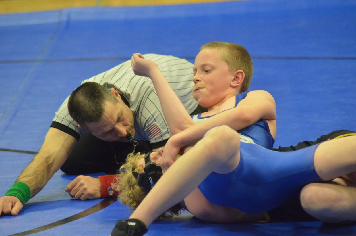 Craig Middle School's Logan Hafey nears completion of a pin Tuesday as part of CMS's dual meet against Meeker. The Bulldogs won, 70-21, in the wrestling team's only home event of the season.