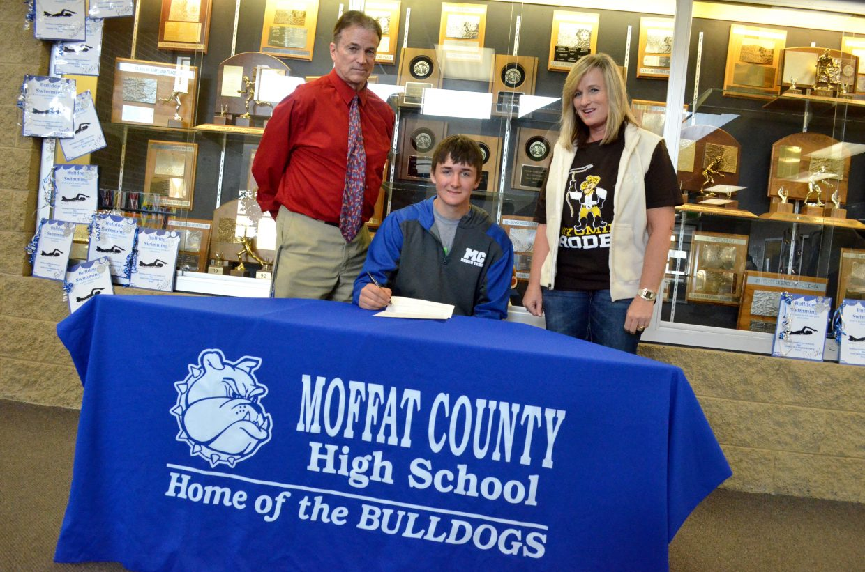 Moffat County High School senior Dusty Taylor signs his letter of intent Tuesday to join the University of Wyoming rodeo team, joined by MCHS Athletic Director Mike Mitchell and Dusty's mother, Pam. Dusty has been involved in rodeo nearly all his life and is expected to be as strong competitor as the rodeo season begins again in April.