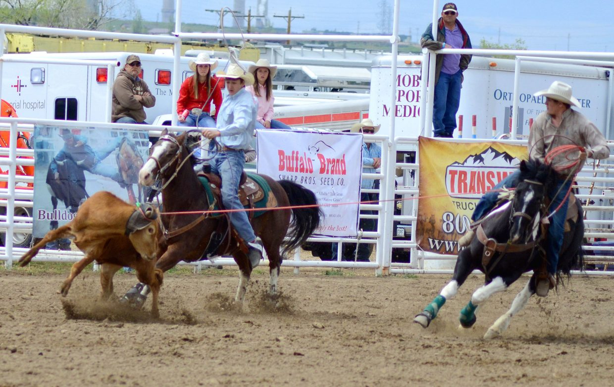 Brothers Dusty, left, and Denton Taylor ride and rope during a rodeo event at the Moffat County Fairgrounds. Dusty, a Moffat County High School senior, signed with the University of Wyoming rodeo team Tuesday, where he will join his older sibling this fall.