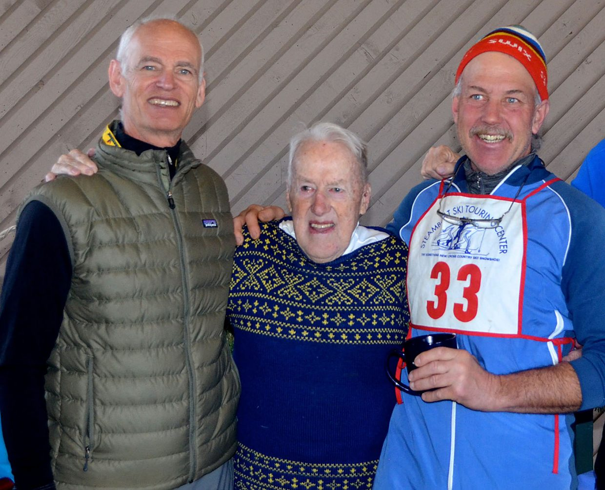 Avid mountain climber, Dr. Dan Smilkstein, left, and longtime Steamboat Springs Winter Sports Club cross country skiing Coach Greg Burkholder, right, were among the many well-wishers wanting to be photographed Saturday with Colorado Ski Hall of Fame member Sven Wiik at his 94th surprise birthday party.