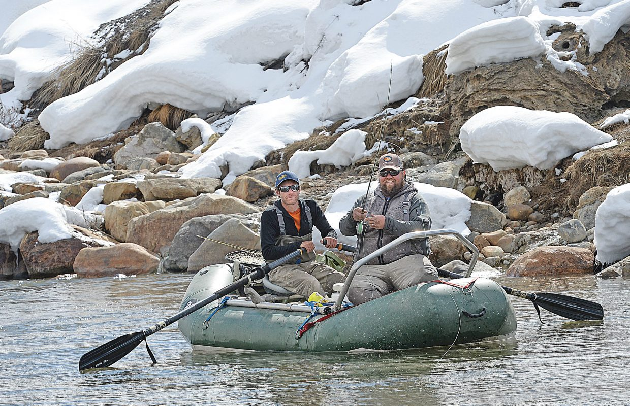 Ryan Herbert, front, and Matt Millner do a little fishing while floating down the waters of the Yampa River Wednesday afternoon. The pair own Yampa Valley Anglers and provide guided fishing services.