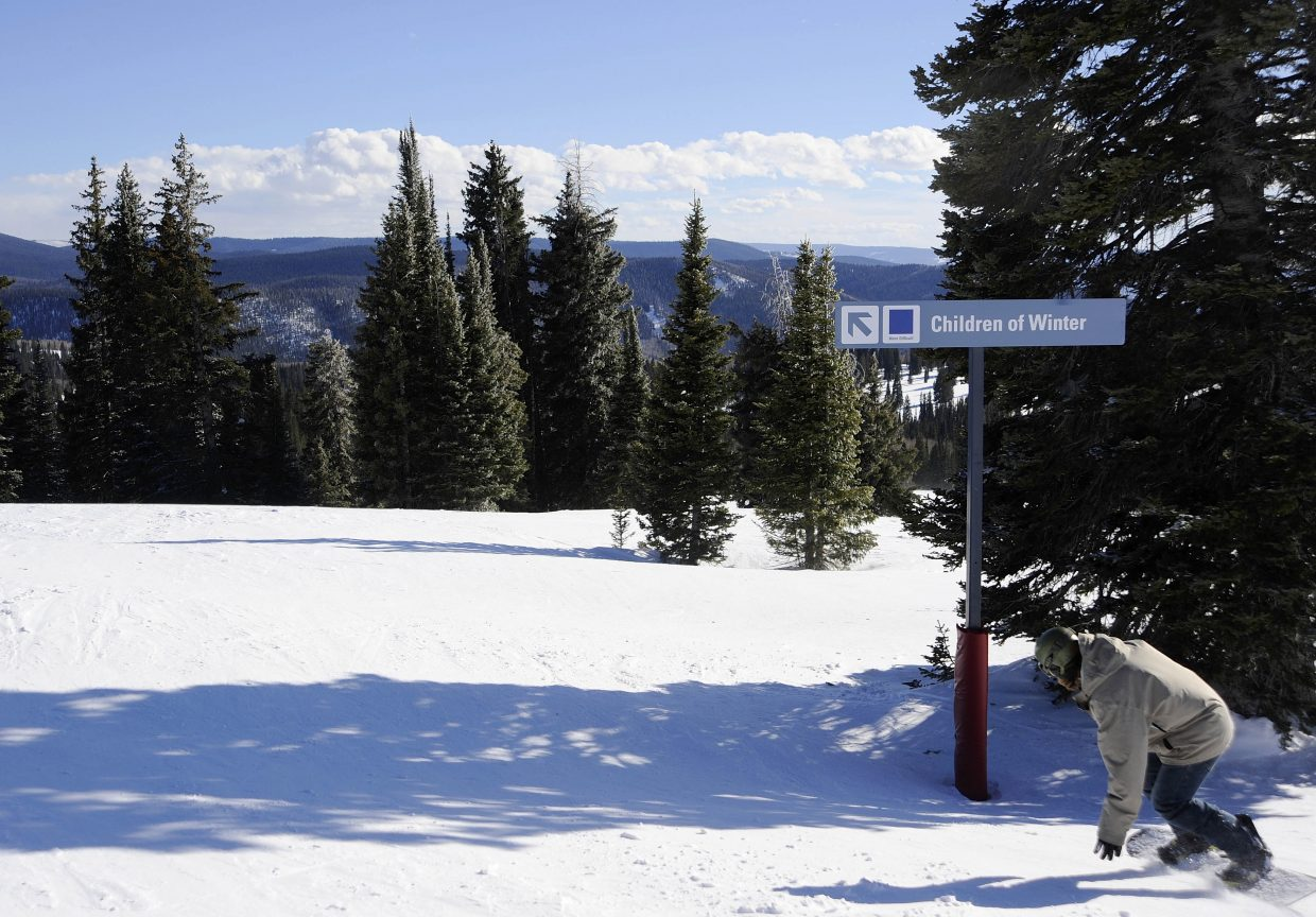 "Alec Sobotka snowboards Wednesday onto the newly-named ""Children of Winter"" trail at Steamboat Ski Area."