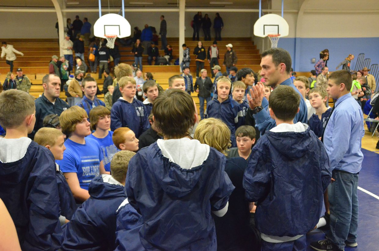 Craig Middle School wrestling coach Tanner Linsacum commends his athletes on their efforts following a dual with Meeker Tuesday at CMS. The meet was the second of the season for the team, which also played second at a tournament Feb. 28 in Hayden.
