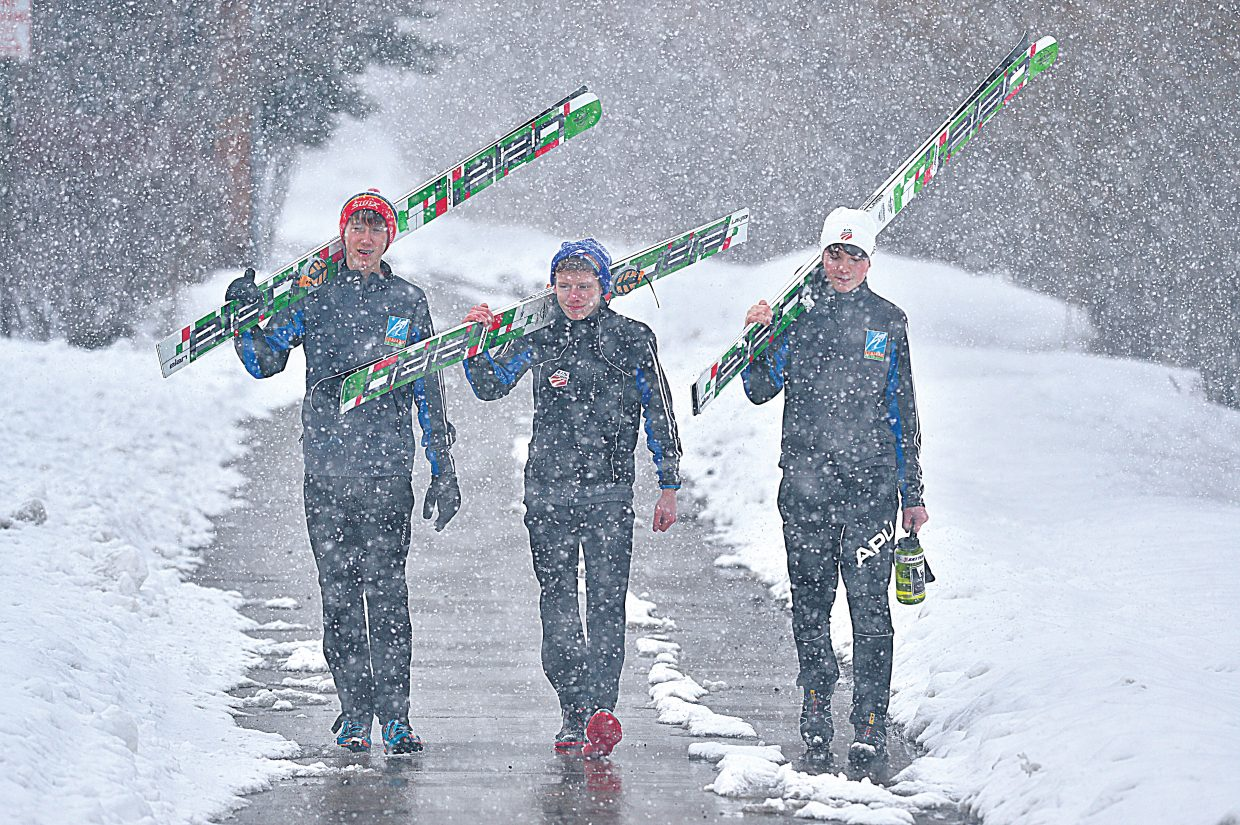 Nordic combined skiers, from left, Eli Hermanson, Nathan Shuttleworth and Hugo Compton walk home after a day training at Howelsen Hill. The young skiers, who live in Alaska, are in town for the Ski Jumping and Nordic Combined 2015 Junior Nationals, which feature 55 skiers from ski divisions in the Rocky Mountain, Intermountain, Central and Alaska.