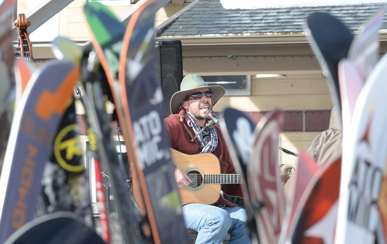 Trevor G. Potter entertains a crowd of skiers, who gathered in front of the Slopeside Grill and were enjoying the sunshine at the base of Steamboat Ski Area Thursday afternoon. Potter and Walt Seabert play at the bar on Thursdays during the ski season.