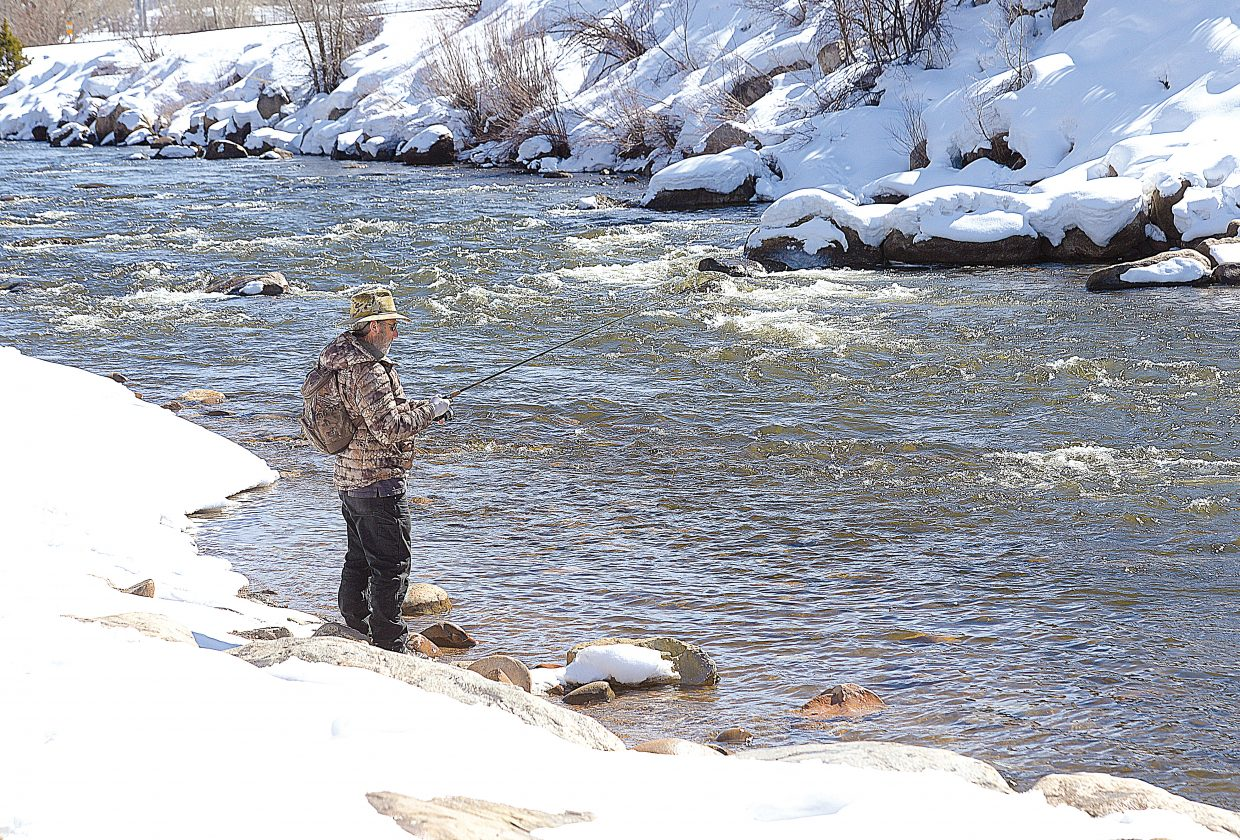 Lowell Konkel tests his luck in the waters of the Yampa River Friday afternoon in downtown Steamboat Springs. A recent string of warm weather had anglers back on the river late last week, but colder temperatures were expected to return today.