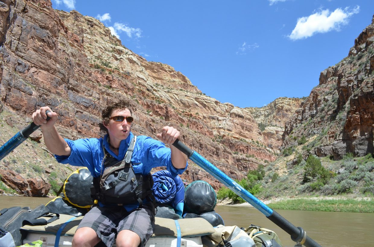 OARS rafting guide Russell Schubert navigates a placid stretch of the Green River well below the extended rapid known as Hell's Half Mile in Dinosaur National Monument in 2016.