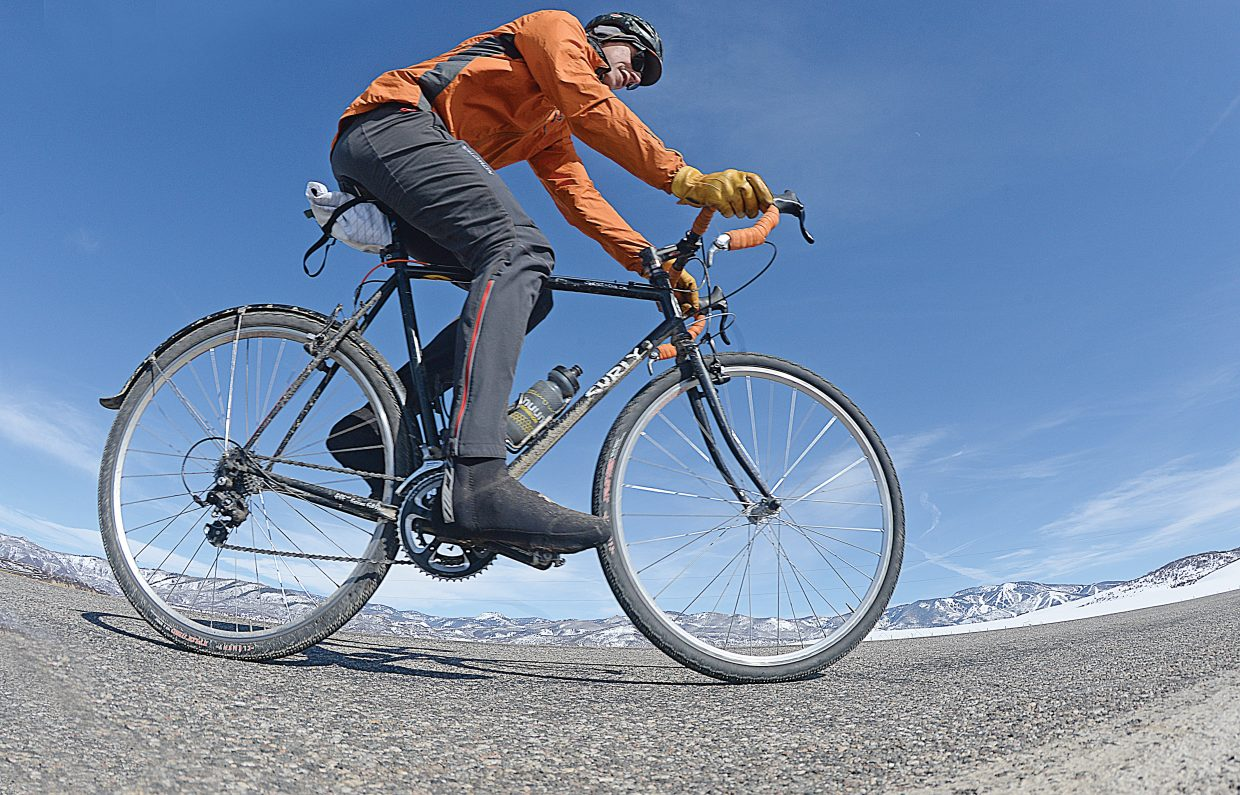 The recent warm weather had road bikers back out on Routt County Road 33 Friday afternoon. Chad Gruben logged a few miles and said he was enjoying the warm weather as he made his way back to Steamboat Springs. Colder temperatures are expected to make their way back into the area today.