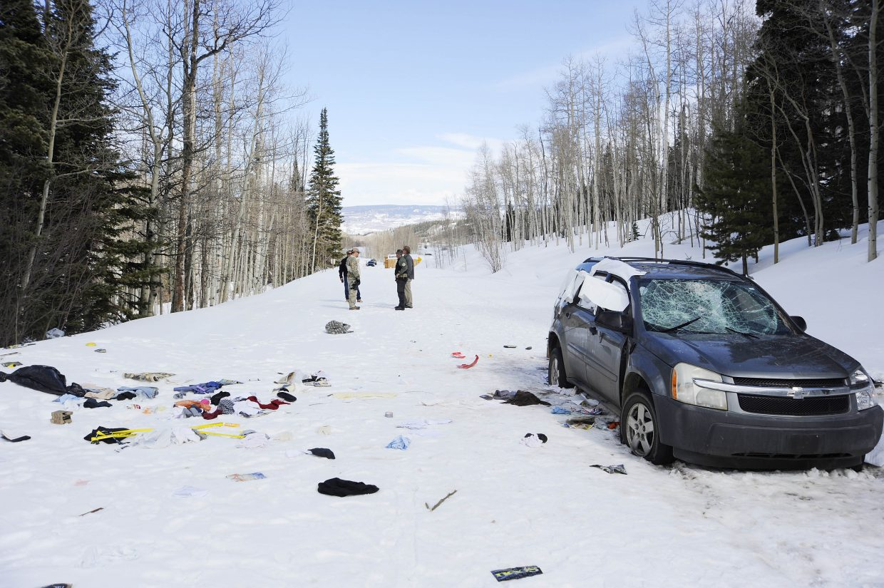 Routt County Sheriff's Office deputies investigate a stolen car found on Routt County Road 7.