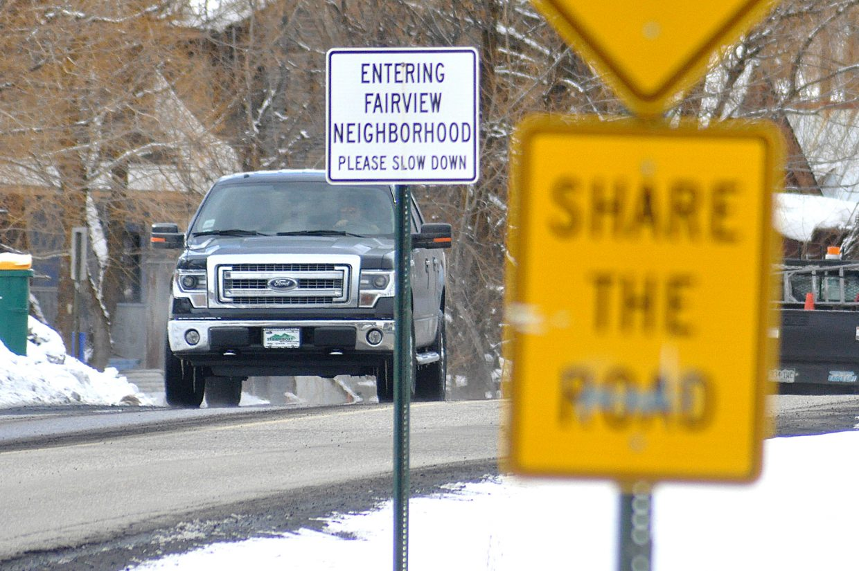 Signs advise vehicles to slow down and share the road with cyclists on 13th Street near the Fairview neighborhood.