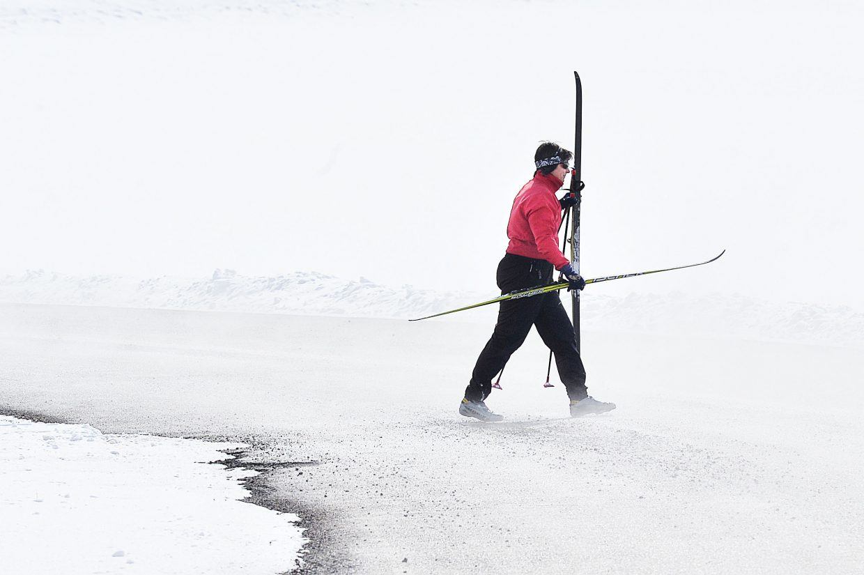 Cross country skiers Carla Jones makes her way across Routt County Road 18 while skiing at Catamount Ranch and Club in Pleasant Valley Wednesday morning.