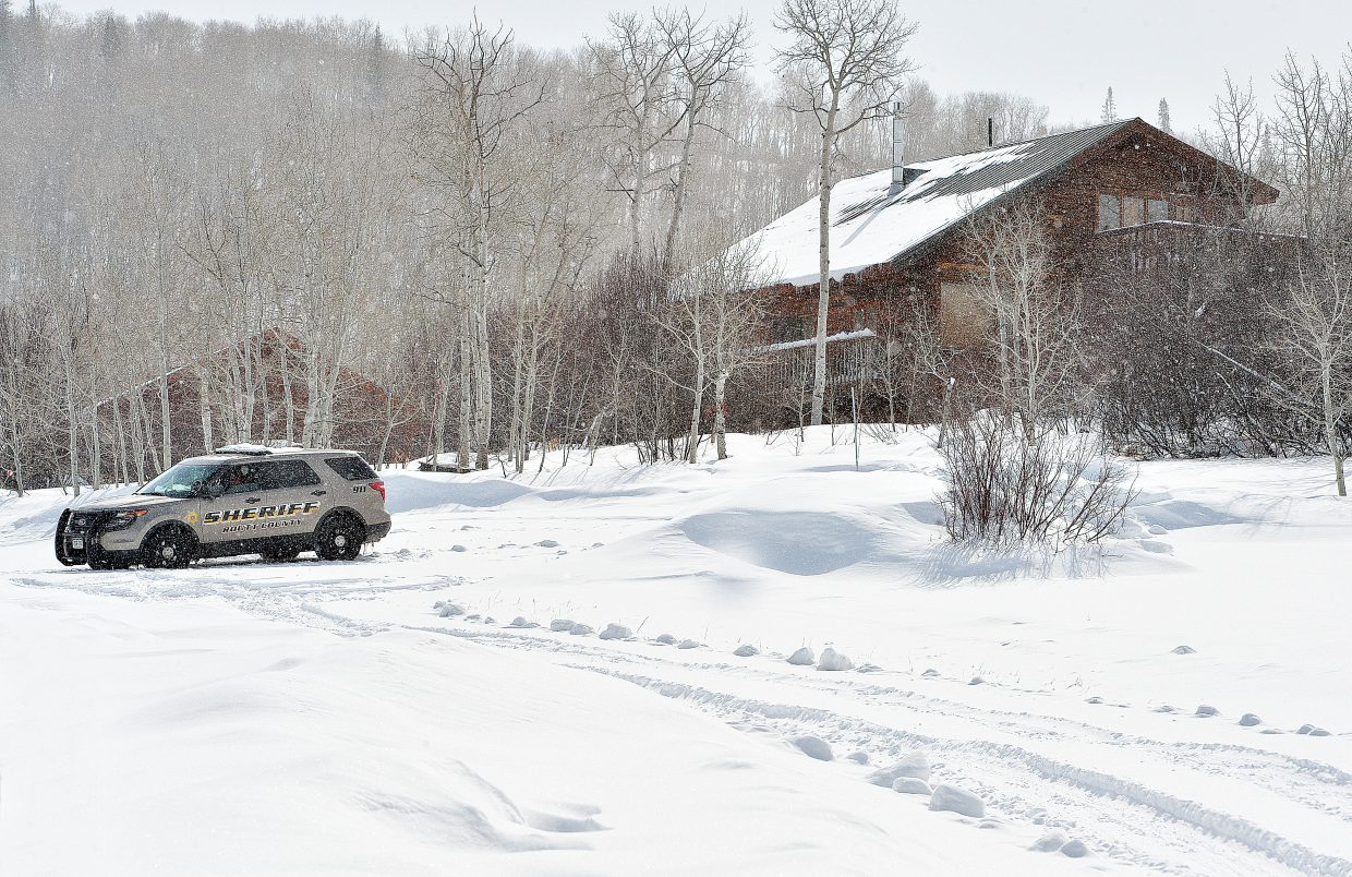 A Routt County Sherriff's vehicle sits outside a home on Wednesday located at 28150 yellow Jacket Drive in Blacktail Mountain Estates between Stagecoach and Steamboat Springs. The home was being treated like a crime scene as deputies looked into the disappearance of Edward Zimmerman.