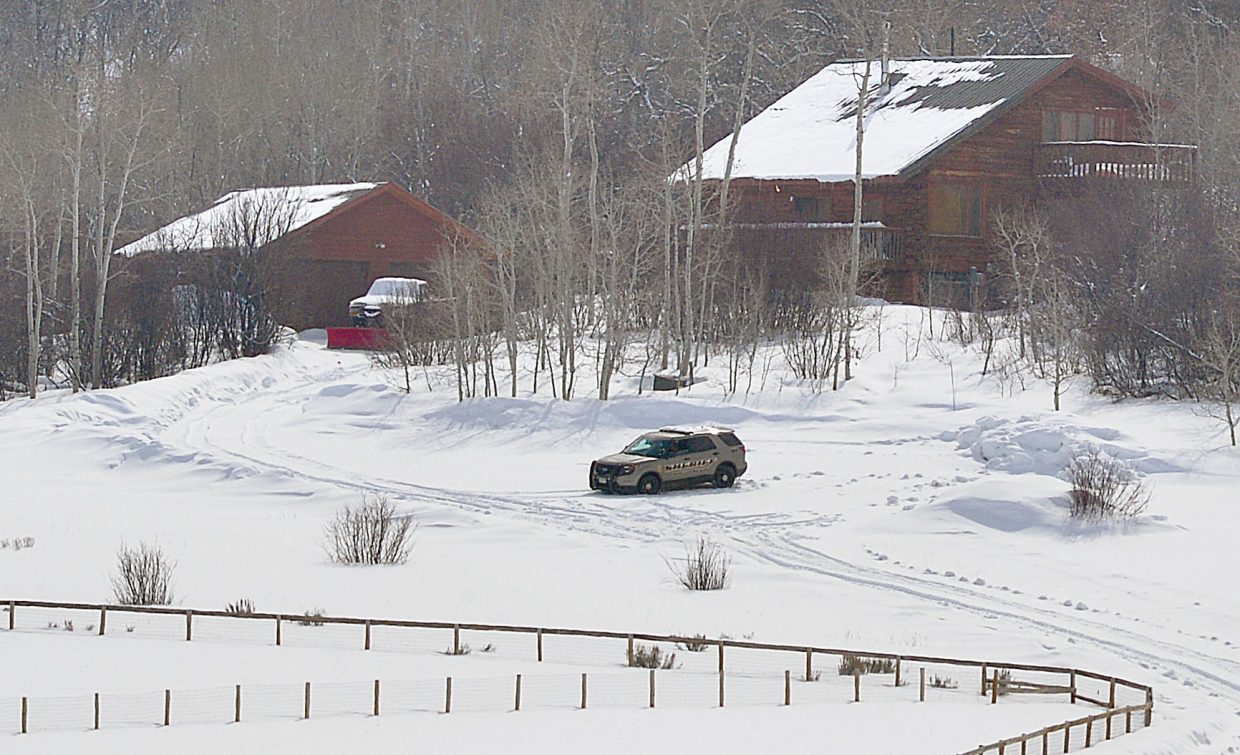 A Routt County Sherriff's vehicle sits outside a home located at 28150 yellow Jacket Drive Wednesday morning. The home is being treated like a crime scene as deputies look into the disappearance of Edward Zimmerman. The Stagecoach man was reported missing Saturday after he failed to show up for his shift at the Three Peaks Grill last Thursday and Friday where he works as a server.