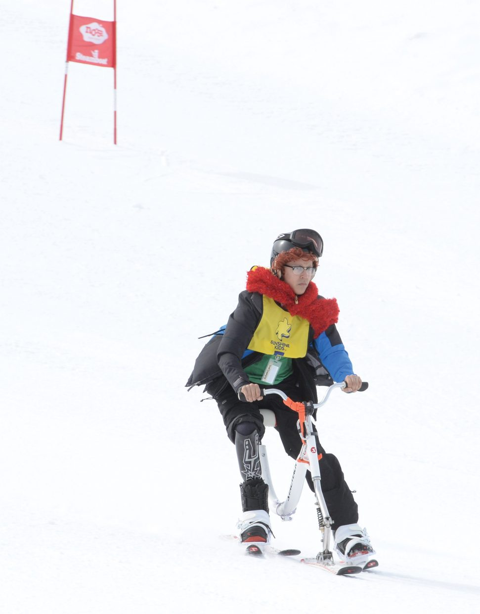 Sunshine Kid Robert Cryz from Laredo, Texas, rides a ski bike down the face of the Bashor ski run Friday afternoon.