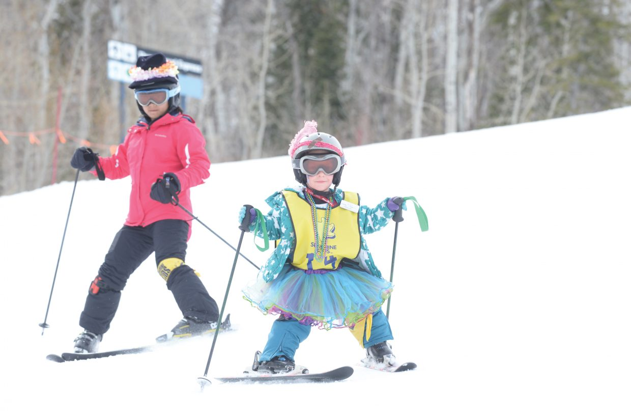 Sunshine Kid Mara Dawkins, 13, from Byers, in the front, skis down Bashor with Sunshine Kid Ahliyalynn Lagasca, 12, from Henderson, Nevada.