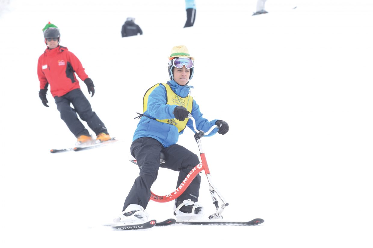 Sunshine Kids Jared Munoz from Clifton, New Jersey, rides a ski bike down the face of the Bashor ski run Friday afternoon.