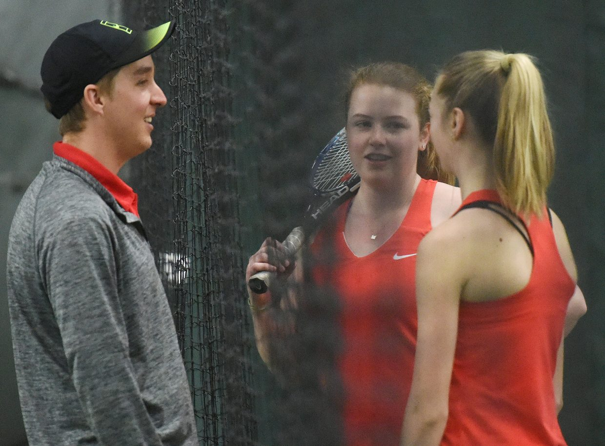 Assistant coach Joseph O'Dell talks with Steamboat's Hadley Magee and Amy Speer on Saturday.
