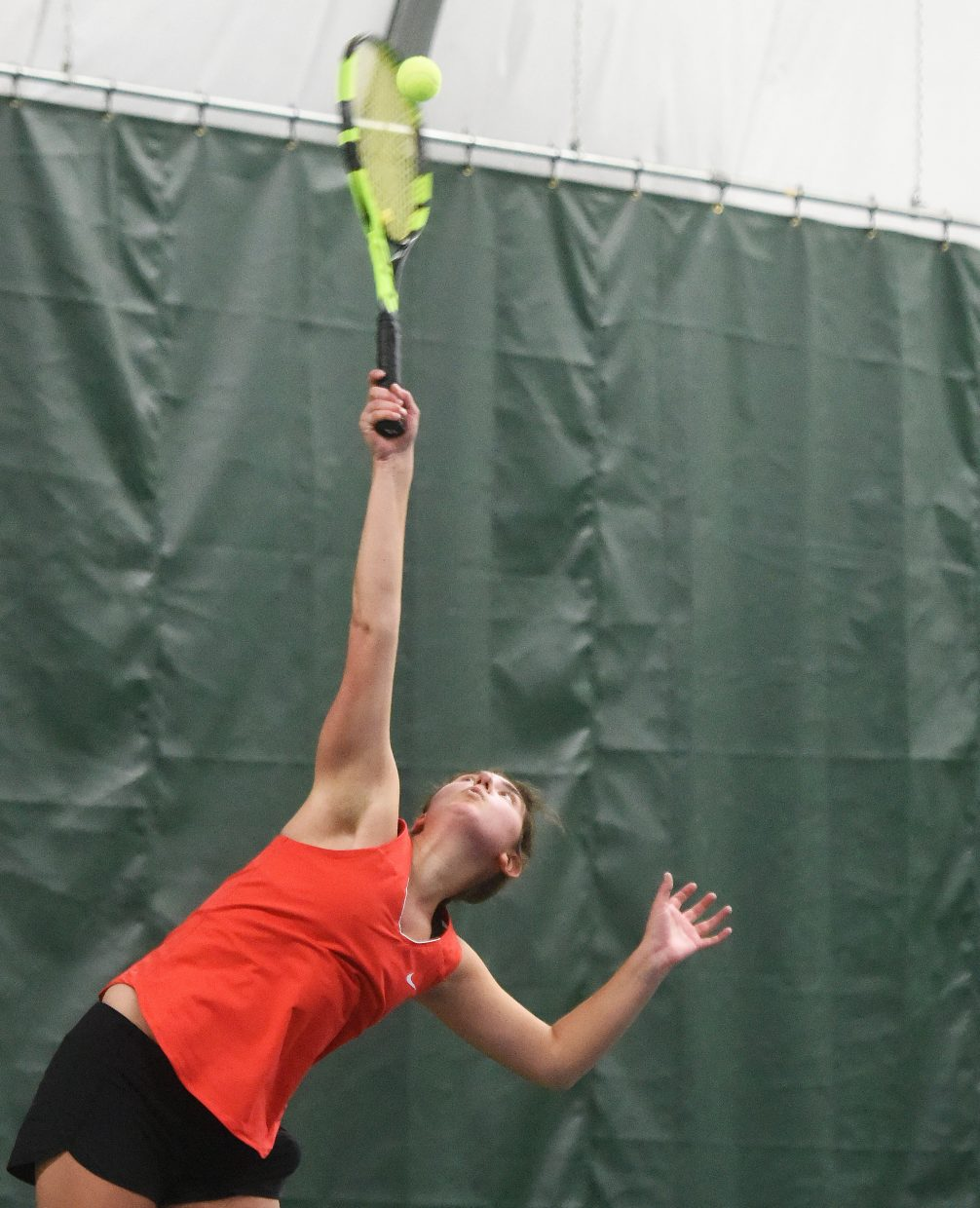 Steamboat senior Maddie Thompson swings for a serve Saturday against Grand Junction.
