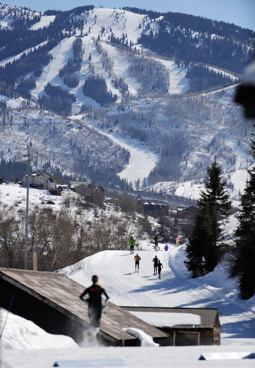 Racers head up Howelsen Hill during the snowshoe portion of the Steamboat Pentathlon on Saturday.