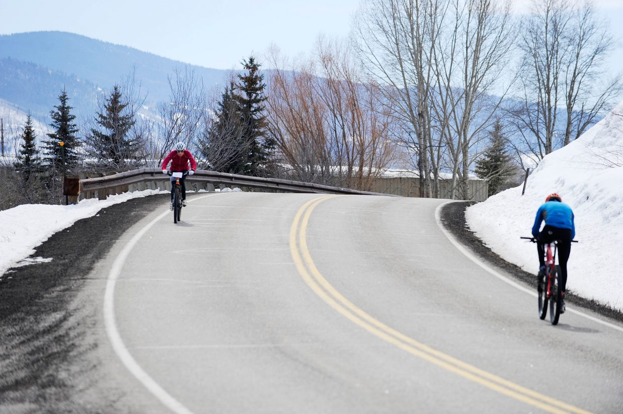 Cyclists ride of River Road during Saturday's Steamboat Pentathlon.