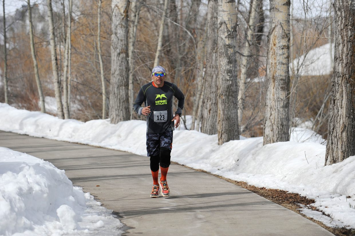 Graham Muir runs on the Yampa River Core Trail while competing in the Steamboat Pentathlon on Saturday.