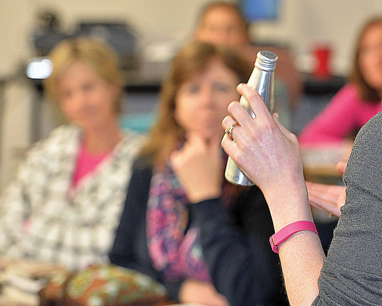 Kate Elkins from Grand Futures Prevention Coalition holds a bottle of marijuana-infused drink while speaking to the Parent Information Committee about marijuana during a recent meeting. She helped educate the parents about the new laws regarding marijuana and how it impacts students and the schools. She also reviewed the many different products, including this marijuana infuses drink, that are offered by legal marijuana shops in Steamboat, and what parents need to learn about when it comes to dealing with their children and marijuana.