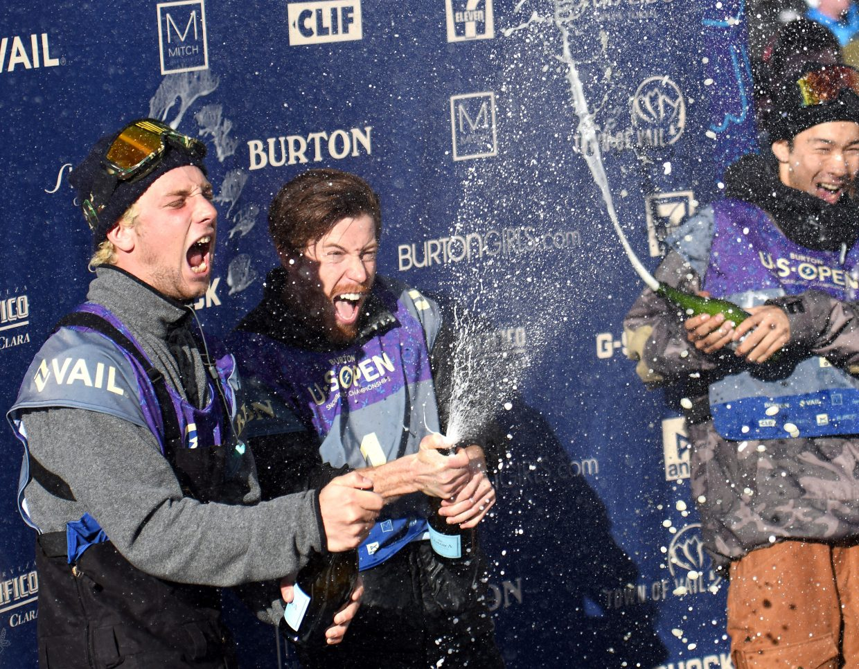 Ben Ferguson, left, Shaun White and Taku Hiraoka celebrate their spots on the podium after Saturday's U.S. Open half-pipe event in Vail.
