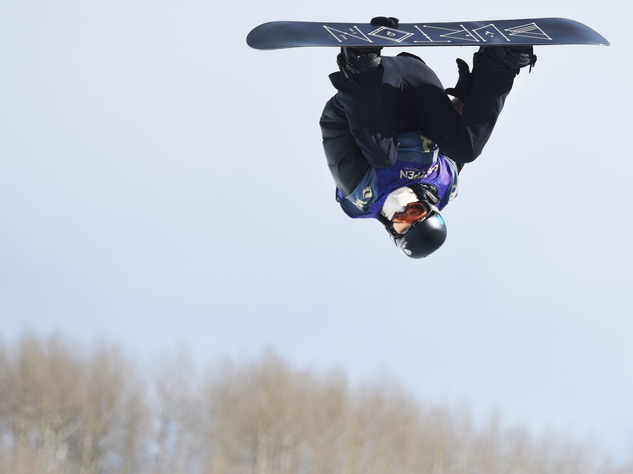 Shaun White spins through a trick Saturday at the U.S. Open half-pipe competition in Vail.