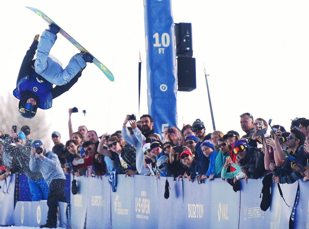 Matt Ladley spins above the crowd Saturday during the U.S. Open half-pipe finals in Vail. He placed fourth at the event.