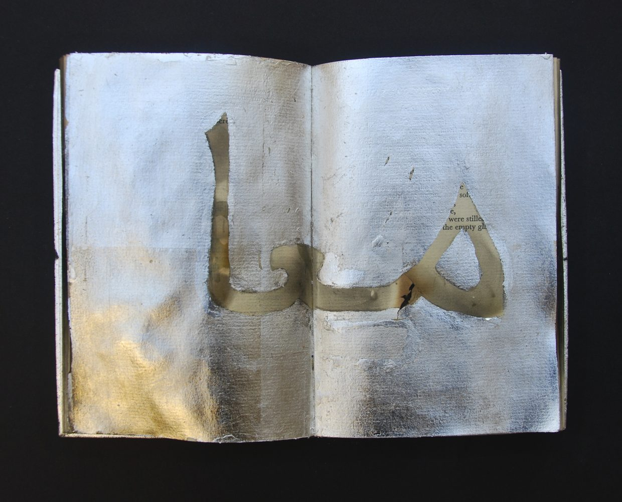 """Book artist Janet Bradley said this piece of her book art means """"together"""" in Arabic."""