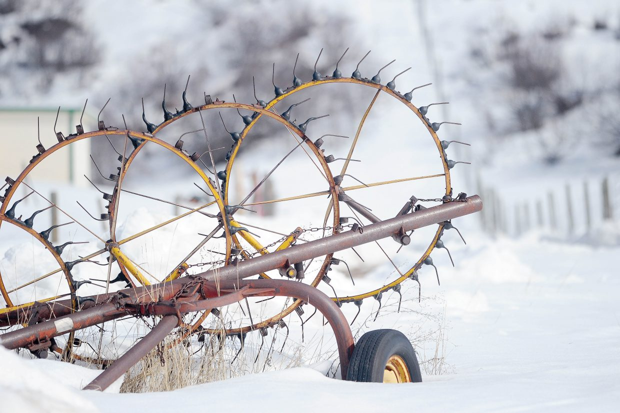 A piece of farm equipment sits on a ranch north of Steamboat Springs.