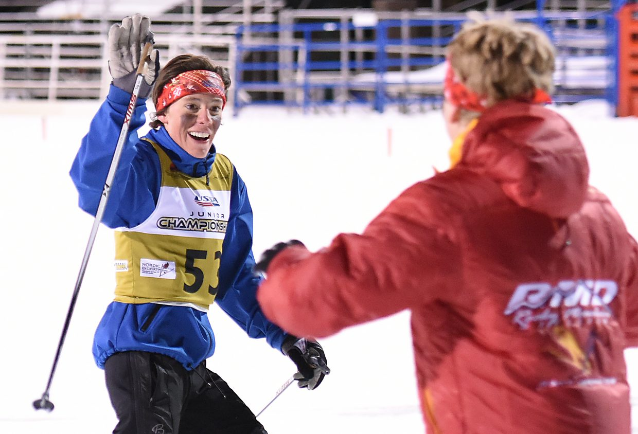 Elijah Vargas, left, and Decker Dean celebrate their second-place finish in Friday's team sprint Nordic combined race at the Junior National Championships event in Steamboat Springs.