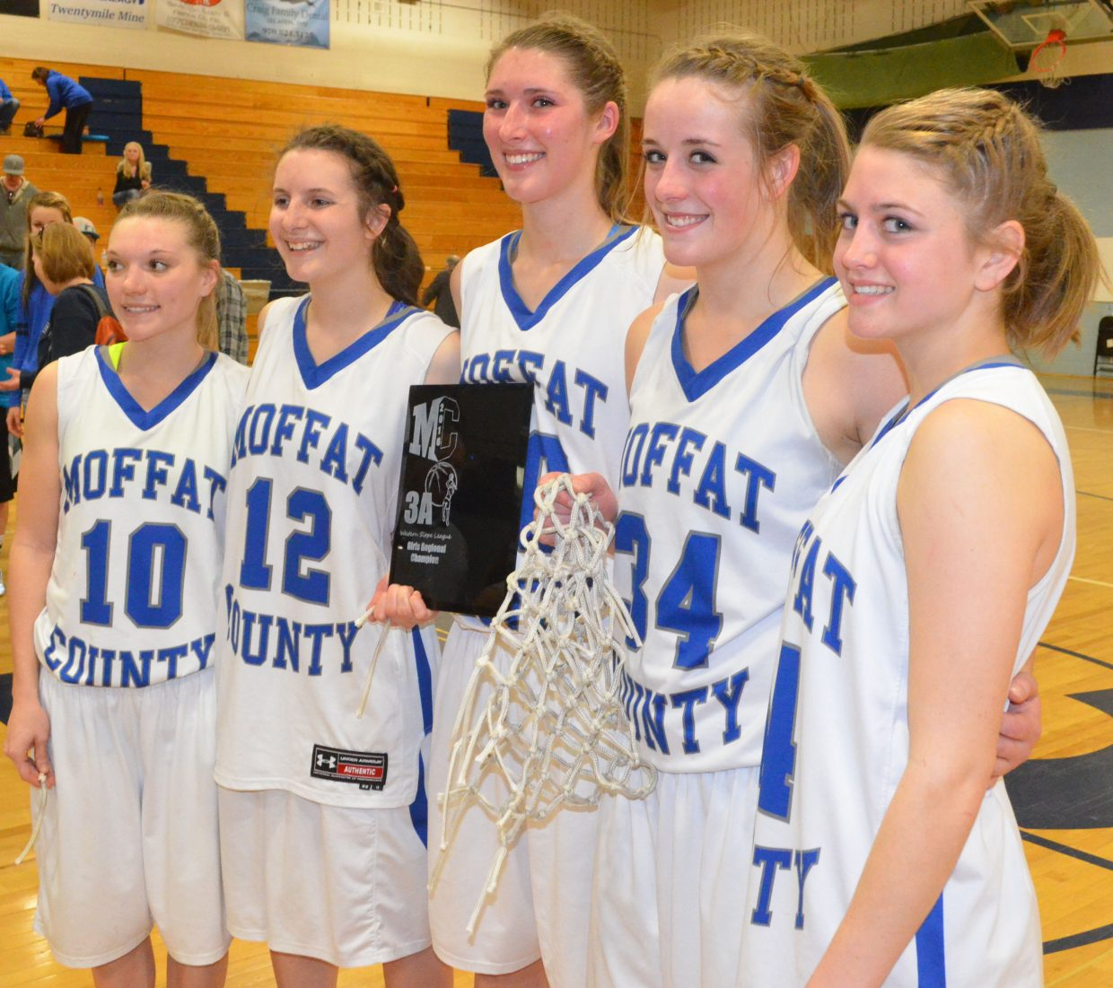 From left, Moffat County High School seniors Kayla Pinnt, Hannah Walker, Katia Voloshin, Morgan Lawton and Leah Camilletti gather at center court with the Lady Bulldogs' regional championship plaque and ceremonial net, cut down from the rim after a Saturday win against Platte Valley. The Sweet 16 game was the last home hoops event for the five seniors.