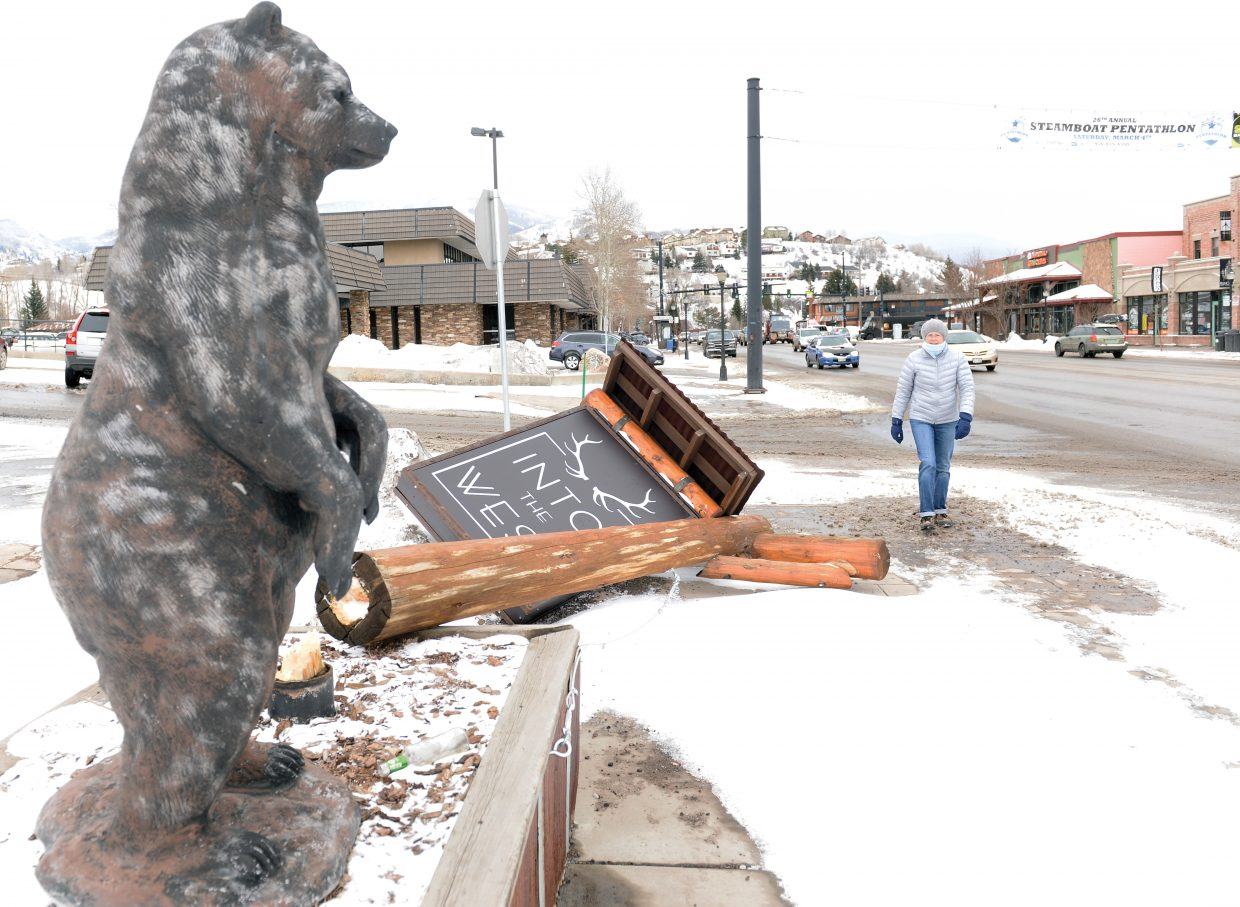 Wind was unbearable: The sign in front of Into the West on Lincoln Avenue was unable to bear the brunt of strong winds Sunday evening and Monday morning. The weather rolled through town bringing blowing snow and colder temperatures.