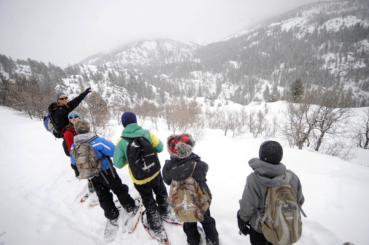 Yampatika naturalist Karen Vail describes the geology in the Fish Creek Canyon area while leading a hike of the Uranium Mine Trail with Steamboat Springs Middle School students in March 2013.