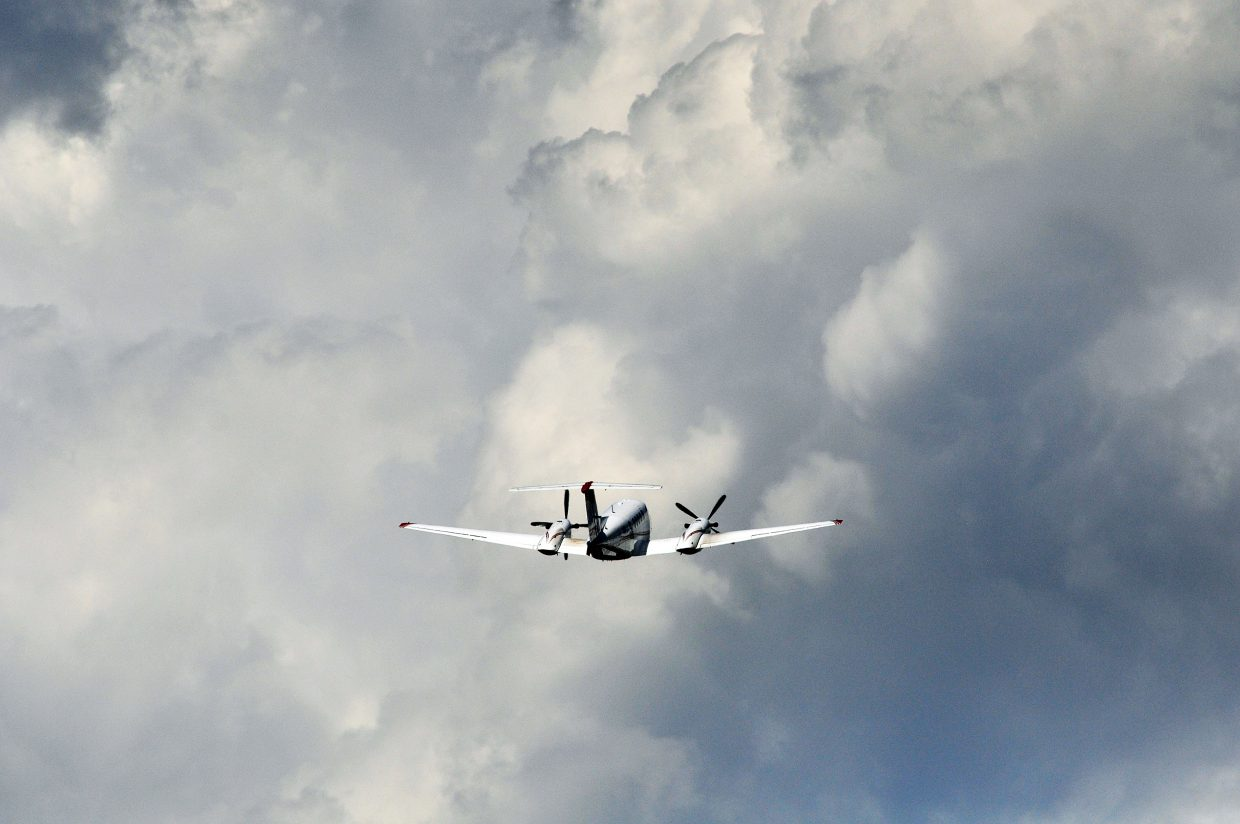 A Beechcraft King Air flies into booming clouds during the 2013 Wild West Air Fest in Steamboat Springs. Five new executive hangars being built this summer at Steamboat Springs Airport will accommodate larger aircraft such as the King Air.