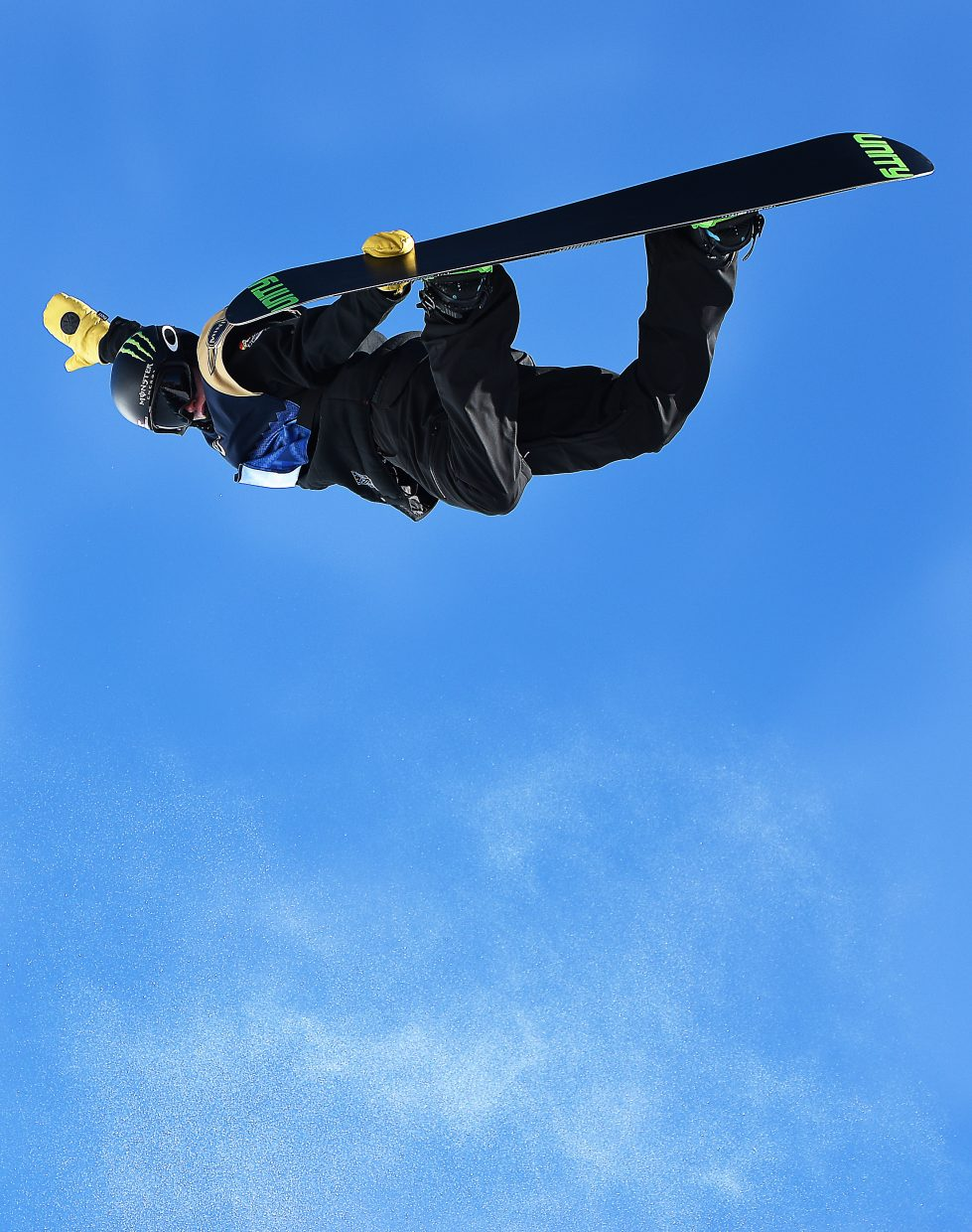 Taylor Gold flies high with a method grab to start his first run Saturday at the U.S. Open men's snowboard half-pipe championships. He was perfect on the run up until the last hit, when he hit the top of the pipe and was launched to the bottom of it. He went on to finish eighth.