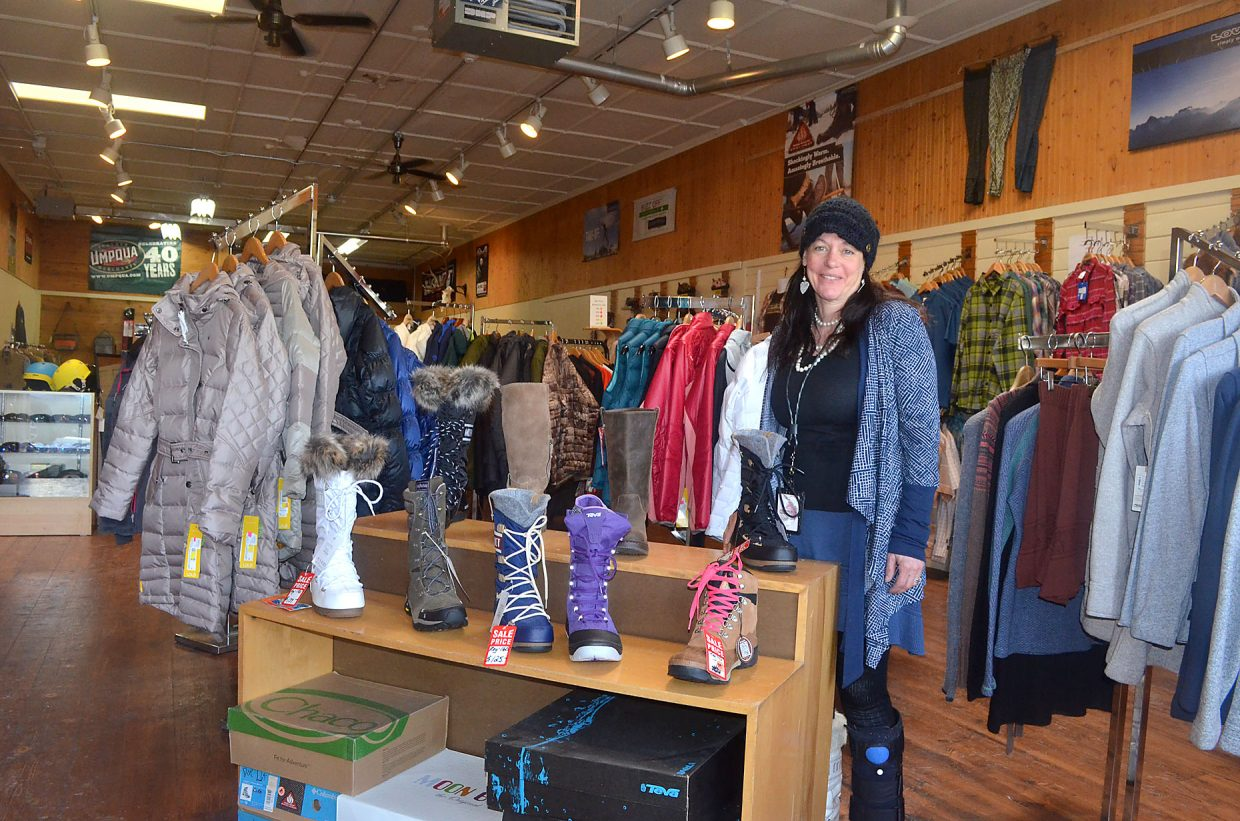 Christine Lee of Straightline Outdoor Sports is staffing the store's temporary second location at 907 Lincoln as the Lee family prepares to vacate their flagship location of 34 years at the corner of Eighth and Lincoln for about nine weeks during renovations beginning April 1.