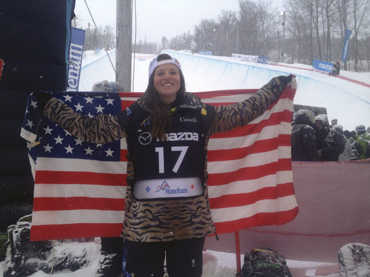 Arielle Gold holds up the American flag after winning a world championships in 2013. Gold will compete again at that event again this week in Sierra Nevada, Spain.