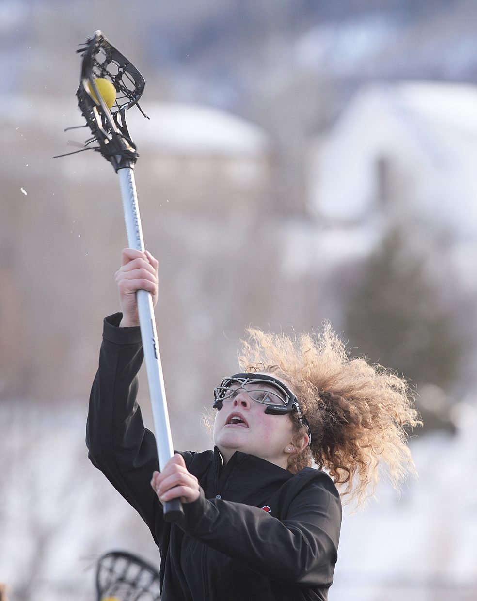 Steamboat Springs freshman Riley Schott catches a pass during a drill in practice Tuesday at the high school's athletic field. The girls lacrosse team heads to Sante Fe, New Mexico, during the weekend to play its first games of the 2017 season.