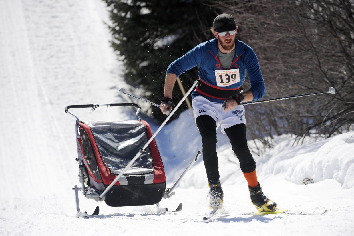 Robbie Shine pulls 17-month-old Emery during the 23rd annual Steamboat Pentathlon on Saturday at Howelsen Hill.