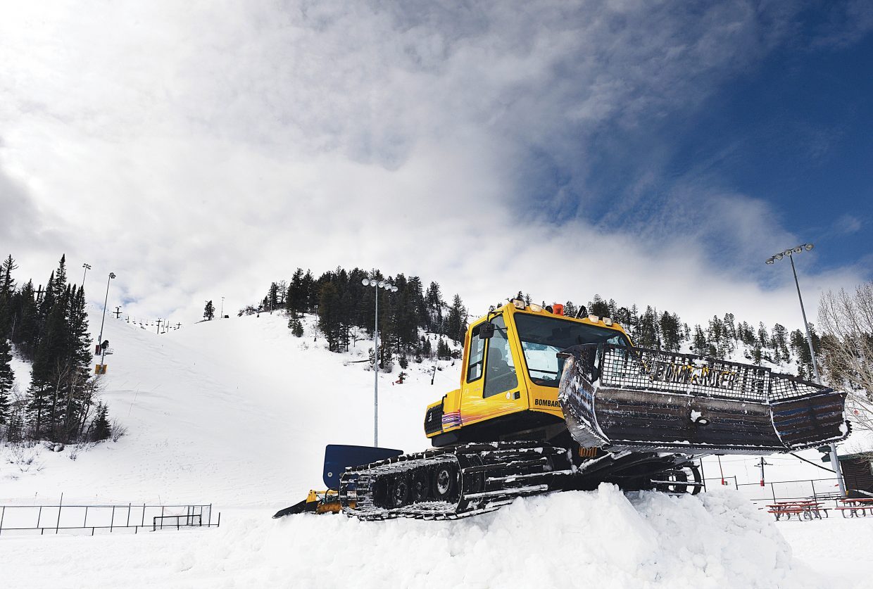 Eric Friese, director of operations for the Steamboat Springs Winter Sports Club, uses a snow groomer to build a stage on the infield of the Vanatta baseball diamond at the base of Howelsen Hill for the NCAA National Skiing Championships.