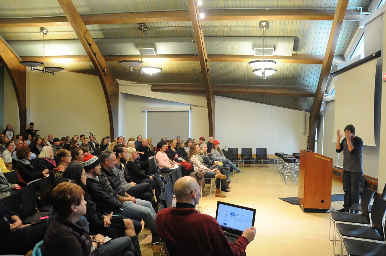 Buck Chavarria talks to a large audience Wednesday about opiate abuse.