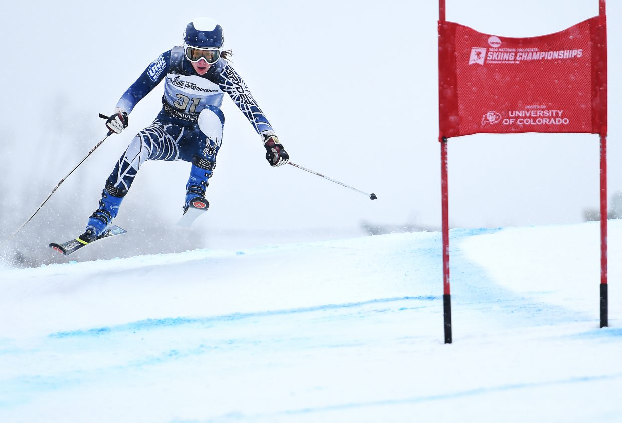 University of New Hampshire skier Genevieve Frigon flies over a section of the course Wednesday during the women's giant slalom race at the NCAA Collegiate Skiing National Championships in Steamboat Springs. Racers tackled All Out, the new alpine ski racing venue at Steamboat Ski Area.